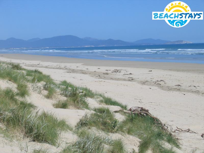 View along beach with Wilsons Promontory in the background